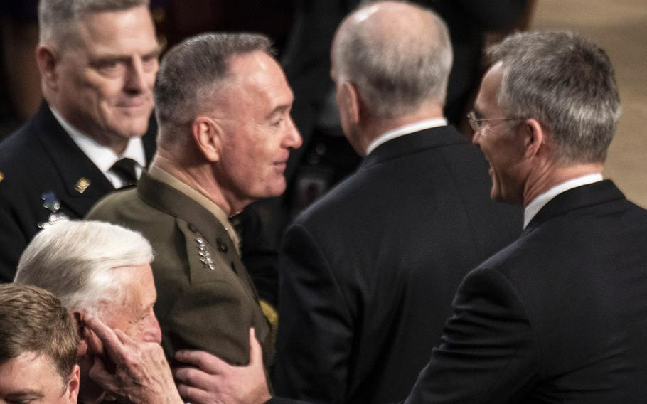 NATO Secretary General Jens Stoltenberg, right, stops to greet Joint Chiefs of Staff Chairman Gen. Joseph Dunford as he arrives to address a joint session of Congress at the U.S. Capitol, April 3, 2019. At left is Army Chief of Staff Gen. Mark Milley.