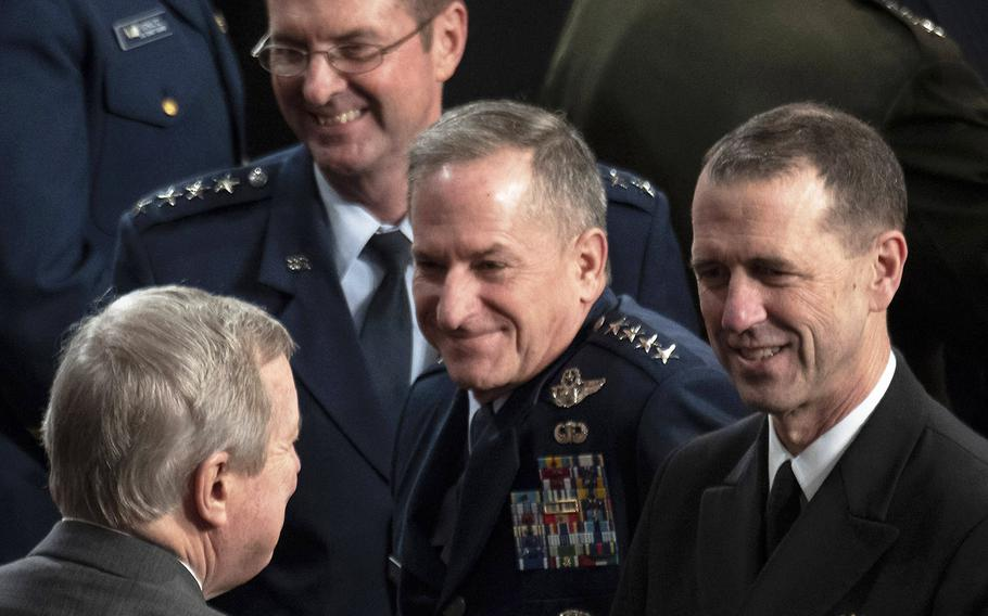 Sen. Dick Durbin, D-Ill., lower left, talks with, top to bottom, National Guard Bureau Chief Gen. Joseph Lengyel, Air Force Chief of Staff Gen. David Goldfein and Chief of Naval Operations Adm. John Richardson before a joint session of Congress at the U.S. Capitol, April 3, 2019.