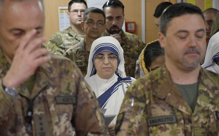 A nun doing charity work in Afghanistan attends a Catholic Easter service with coalition troops at NATO's Resolute Support headquarters in Kabul on Sunday, April 21, 2019.