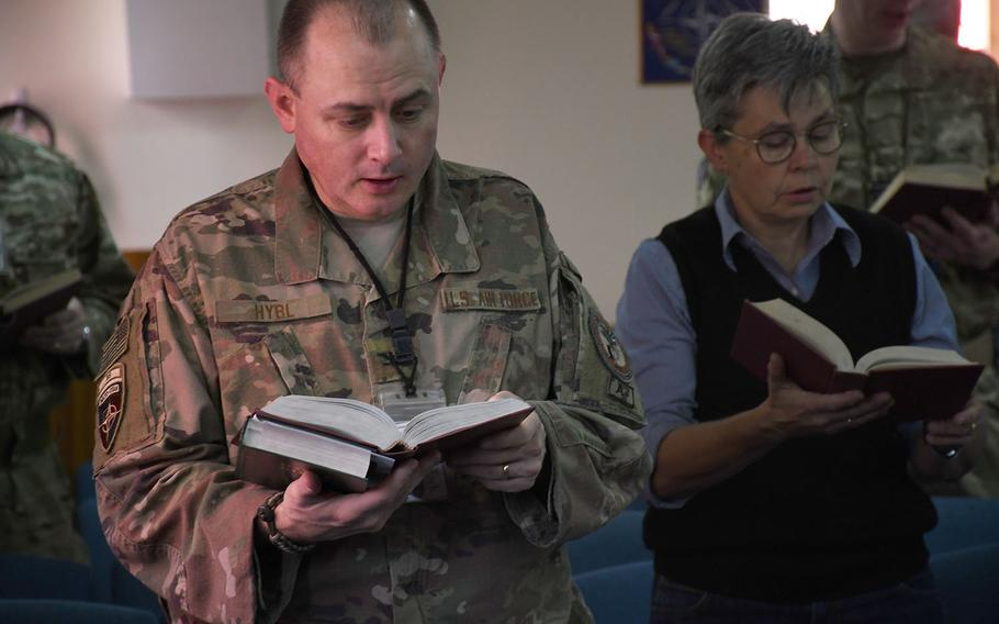 Servicemembers and contractors from the U.S. and other NATO coalition countries sing hymns at a Protestant Easter service at NATO's Resolute Support headquarters in Kabul, Afghanistan, on Sunday, April 21, 2019.