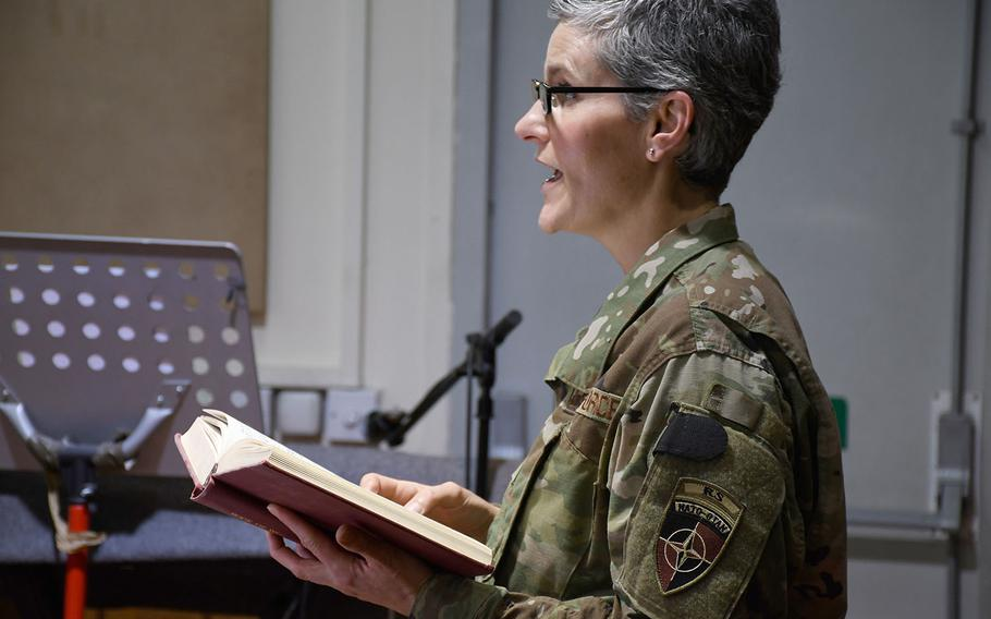 Forward Support Base Chaplain Maj. Kathy Scott leads a traditional Protestant Easter service at NATO's Resolute Support headquarters in Kabul, Afghanistan, on Sunday, April 21, 2019, one of several Christian services available to troops and contractors living on the base throughout the day.