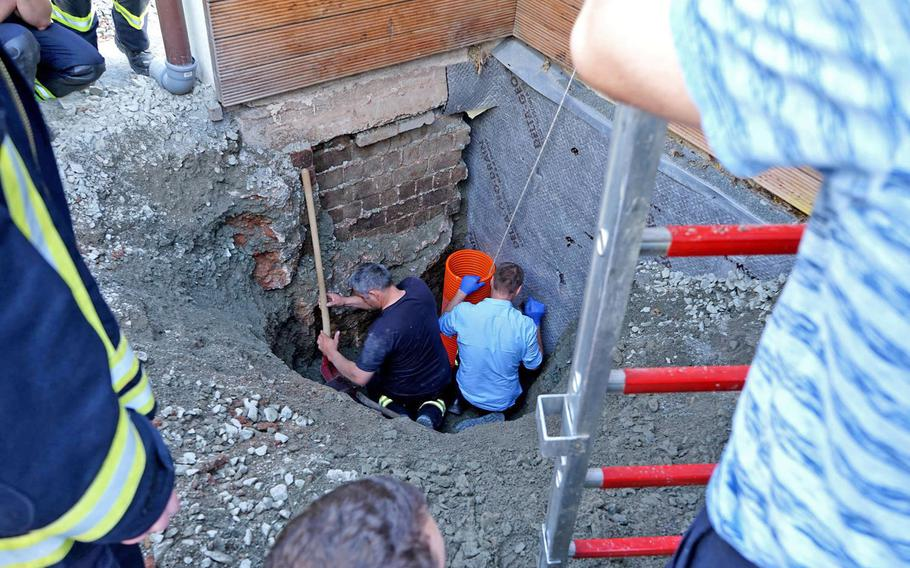 Police work to rescue a 17-month-old boy who fell into a nearly 10-foot shaft in Erzenhausen, Germany, just north of Ramstein Air Base, on April 22, 2019.