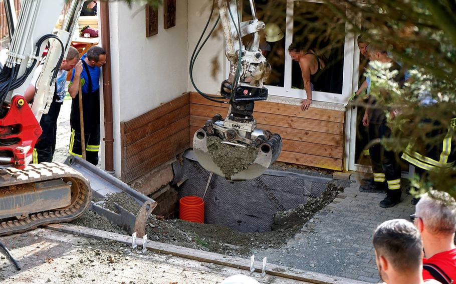Fire department personnel use a small excavator to rescue a toddler who fell into a nearly 10-foot shaft in Erzenhausen, Germany, just north of Ramstein Air Base, on April 22, 2019.
