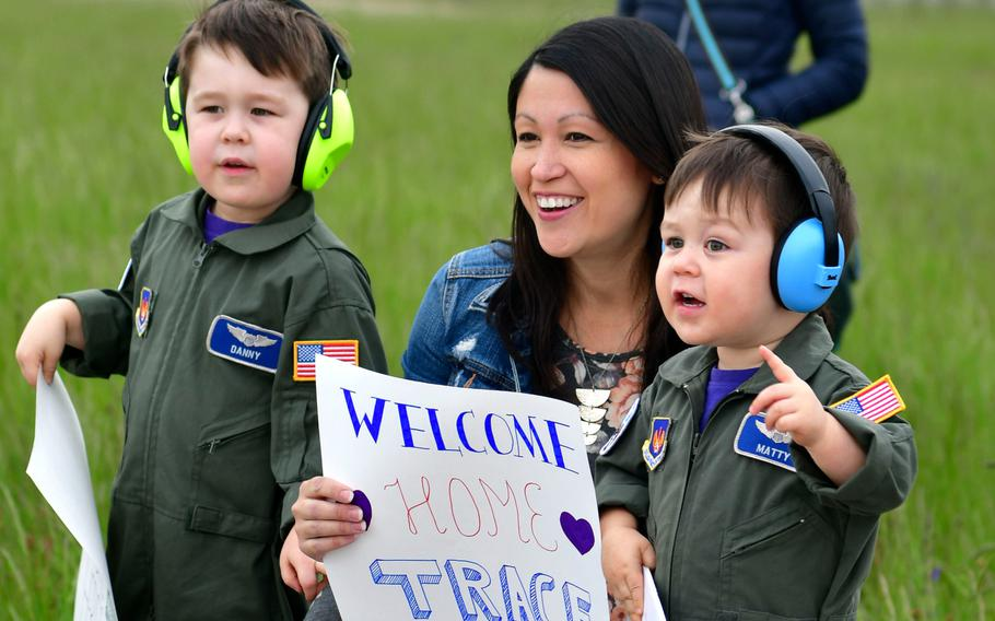 Family members of redeploying airmen with the 510th Fighter Squadron, 31st Fighter Wing, Aviano Air Base, Italy, excitedly await the arrival of their loved ones at Aviano's airfield, on Tuesday, April 30, 2019.