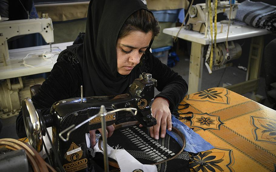 Zahra, a worker at a factory in Kabul, sews a shemagh for Combat Flip Flops, a company started by a U.S. veteran and Ranger who deployed to Afghanistan and wanted to invest in the country. Zahra asked to be named by her first name, as she worries for her safety in working as a woman in Afghanistan.