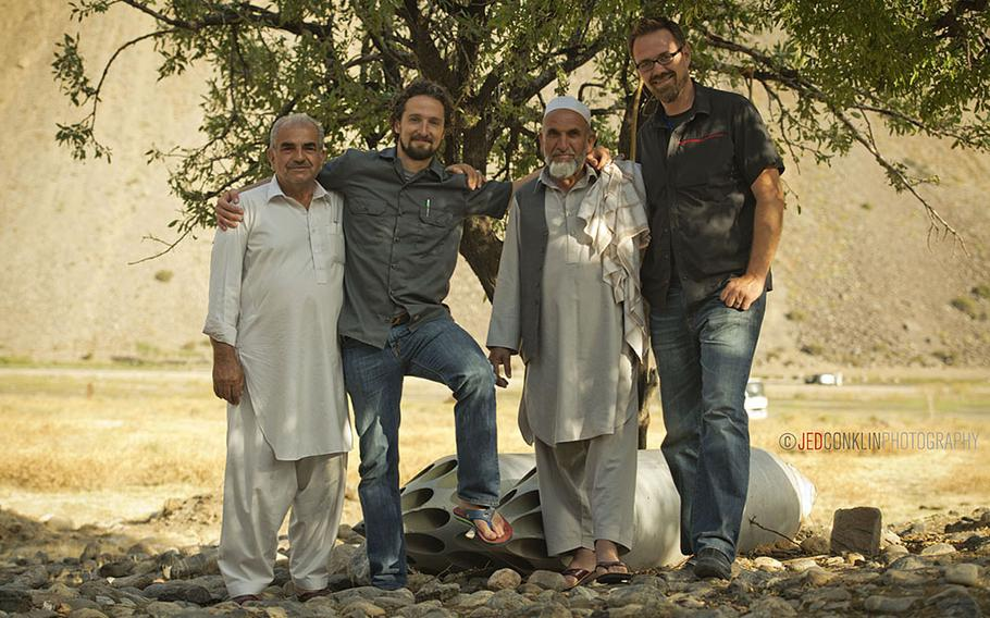 Matt Griffin, his brother-in-law Andy Sewrey, and two relatives of their security team in Afghanistan pose for a photo while on a visit to the tomb of Ahmed Shah Massoud in the Panjshir Valley north of Kabul.