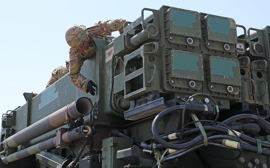 A Soldier from the 5th Battalion 7th Air Defense Artillery Regiment, works on top of the Patriot Missile Defense System during missile transport and reload training in Koper, Slovenia, June 3, 2019 as part of the joint exercise Astral Knight 19.