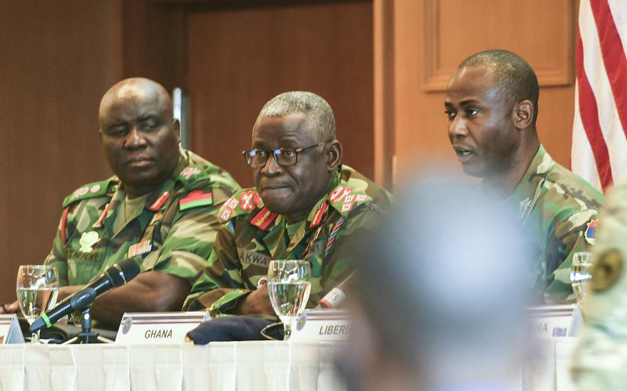 Malawi's Gen. Vincent Thom Nundew, left, and Ghana's Lt. Gen. Obed Boamah Akwa, center, look on as Liberia's Maj. Gen. Prince Charles Johnson III, right, speaks during a panel discussion on the importance of empowering noncommissioned officers at a conference U.S. Africa Command hosted for African senior enlisted leaders at the Edelweiss Lodge and Resort in Garmisch-Partenkirchen, Germany, on Tuesday, August 13, 2019.