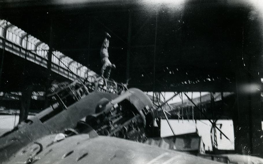 """Ben Reise does a handstand on top of a German plane """"that never got off the ground,"""" he wrote on the back of the photo. He was an avid gymnast and """"the most remarkable handstand person,"""" according to Ruth Reise."""