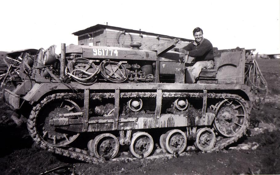 Ben Reise sits on a tank while serving overseas in this photo from 1943.