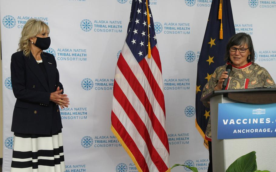 Val Davidson, right, the president of the Alaska Native Health Tribal Health Consortium, introduces first lady Jill Biden, left, during a visit Wednesday, July 21, 2021, to the consortium office in Anchorage, Alaska. Biden stopped in Alaska's largest city as she traveled to Tokyo, her first solo international trip as first lady, leading a U.S. delegation to the Olympic Games.
