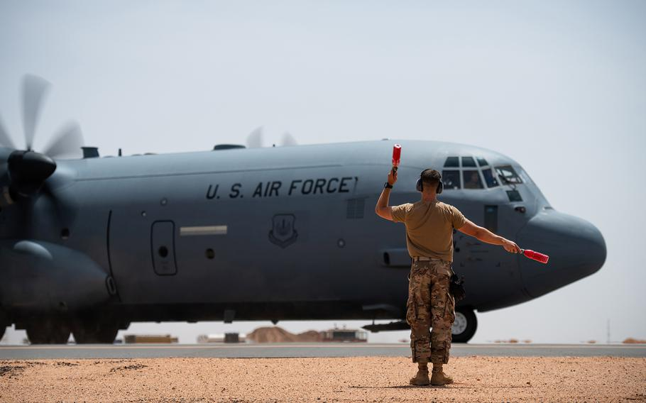 U.S. Air Force Tech. Sgt. Daniel Peterson marshals a C-130J Super Hercules at Nigerien Air Base 201, Agadez, Niger, on Aug. 3, 2019. The U.S. Air Force has expanded its mission out of the base with the start of drone operations, U.S. Africa Command said Friday, Nov. 1, 2019.