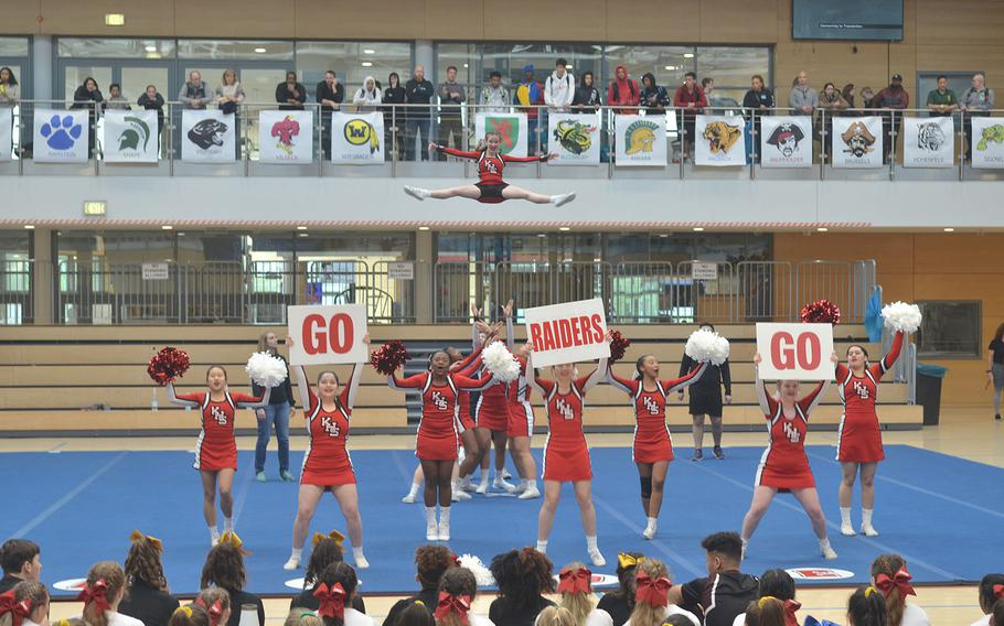 The Kaiserslautern cheer squad used signs and partner stuns during its routine for the 2020 DODEA-Europe Cheerleading tournament that was held Saturday, Feb. 22, 2020, on Clay Kaserne in Wiesbaden, Germany.
