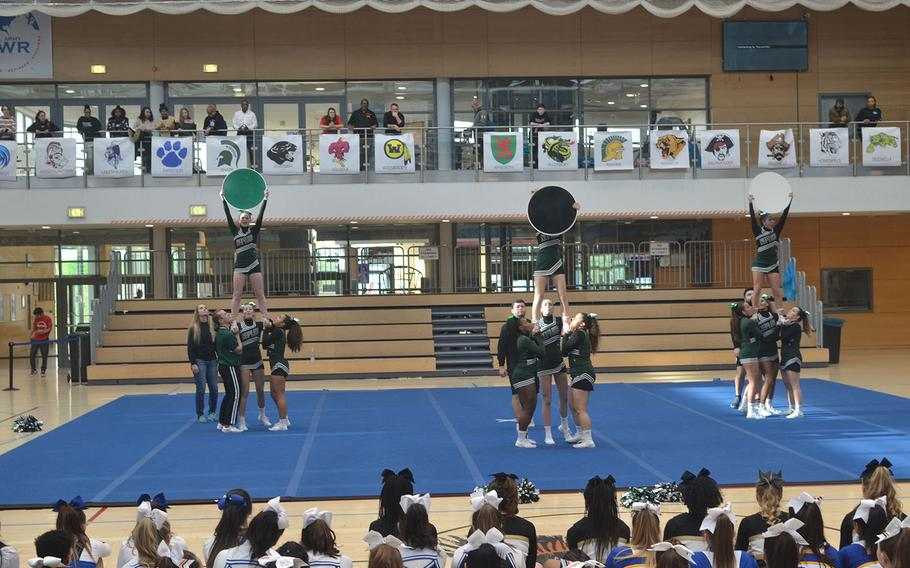 The Naples cheer squad used signs during the its routine at the 2020 DODEA-Europe Cheerleading tournament, held on Feb. 22, 2020 at Clay Kaserne in Wiesbaden, Germany.