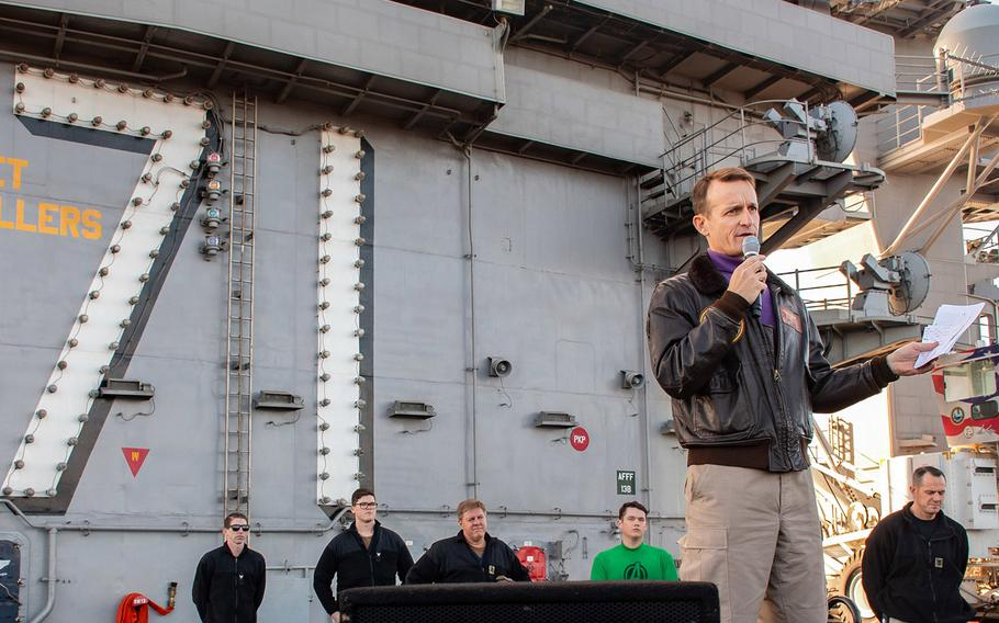 In a Dec. 15, 2019 photo, Capt. Brett Crozier, commanding officer of the aircraft carrier USS Theodore Roosevelt, gives remarks during an all-hands call on the ship's flight deck.