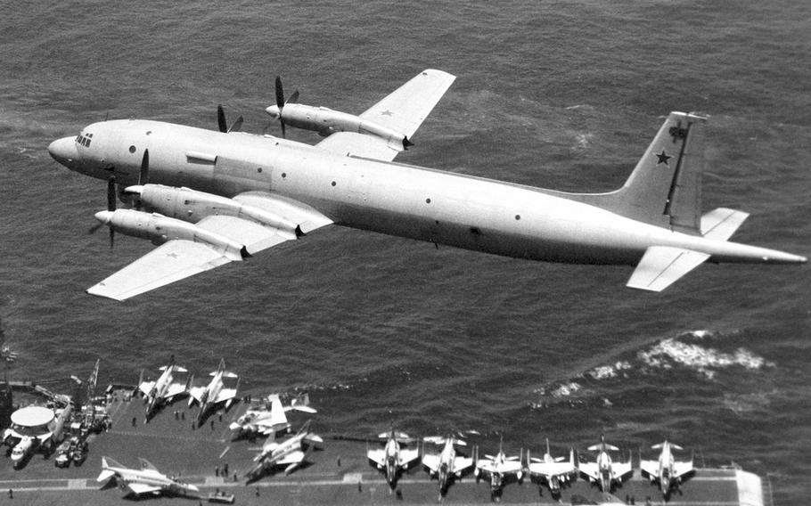 In a May, 1979 photo, a Soviet I1-38 May reconnaissance and anti-submarine warfare aircraft passes low over the flight deck of the aircraft carrier USS Midway.
