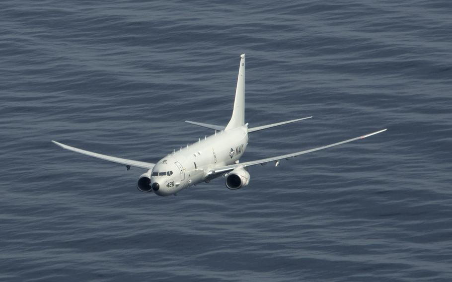 A P-8A Poseidon maritime patrol and reconnaissance aircraft flies over the Atlantic Ocean, March 29, 2020. A Russian fighter jet's intercept of a P-8A over the Mediterranean Sea on Wednesday risked a collision, the U.S. Navy said.