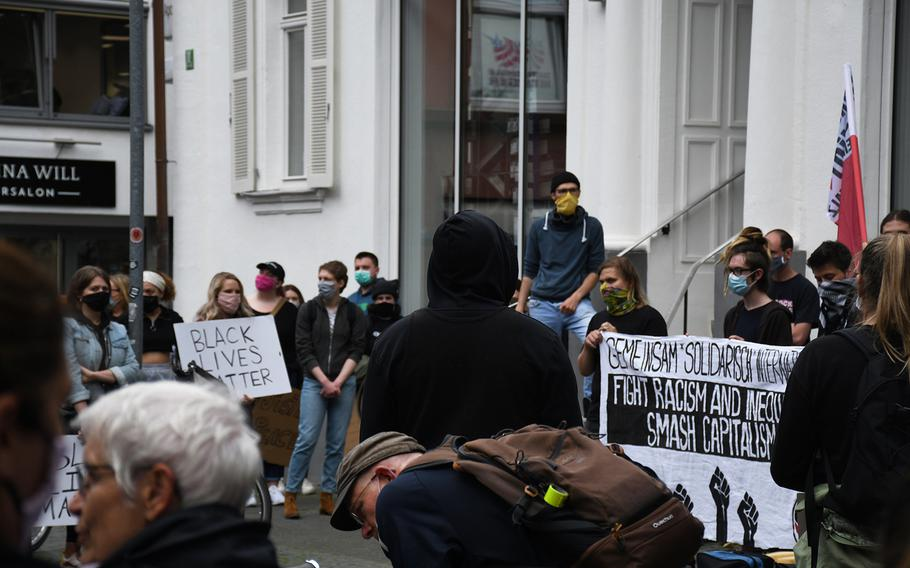 Demonstrators are pictured here during a rally in downtown Kaiserslautern to oppose racism on Thursday, June 4, 2020, as a sign of solidarity with American protests in several cities spurred by police brutality.