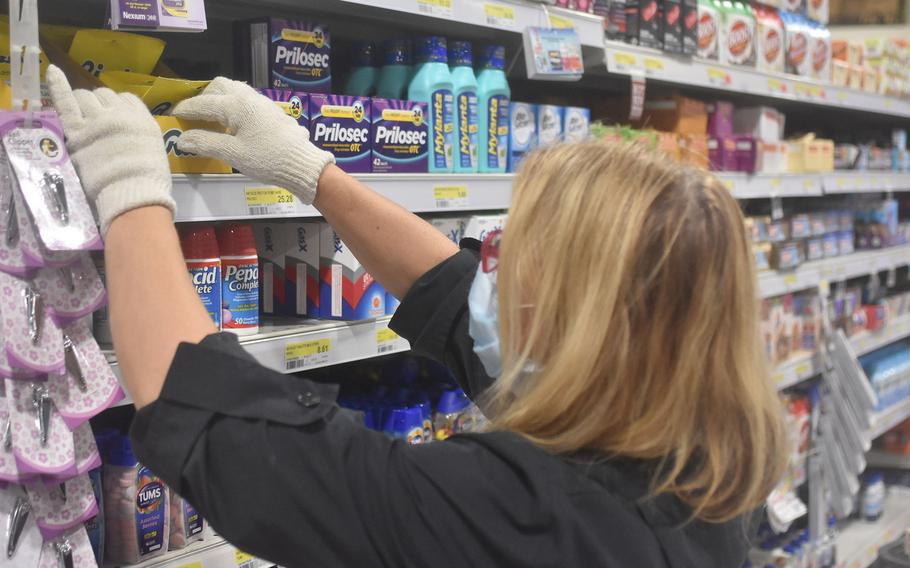 Claudia De Luca Ceros checks stock in the medicine aisle at the commissary at Aviano Air Base, Italy, on May 10, 2020. Stockers have been put to the test at Aviano and elsewhere during huge sales for DECA during the coronavirus pandemic.
