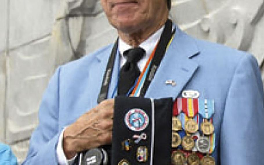 Charles Garrod, 73, stands during the playing of the South Korean national anthem during a ceremony marking the 57th anniversary of the Inchon landing.