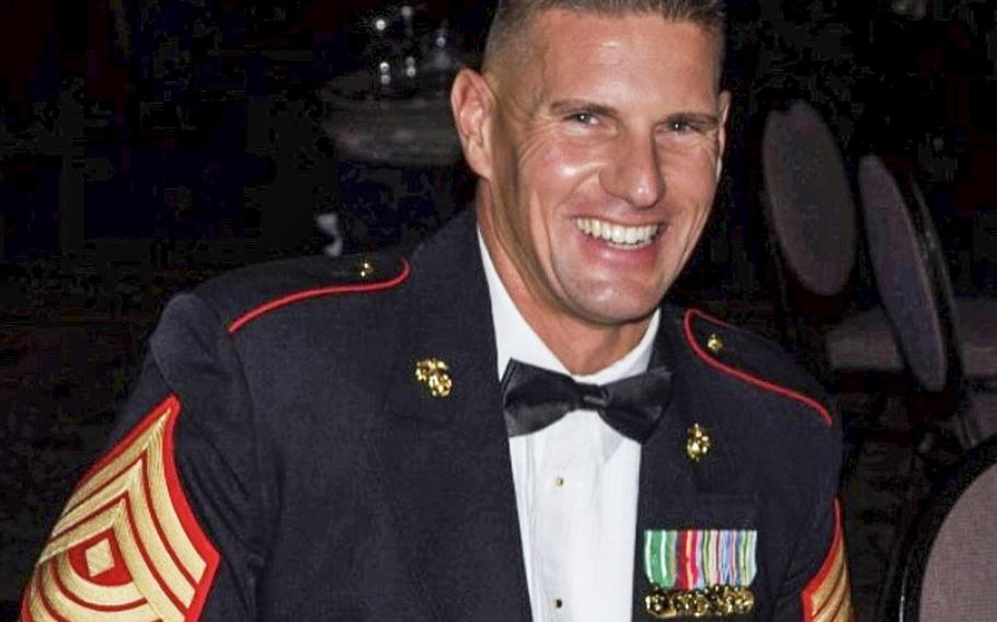 Kelly Murphy is pictured during his 22 years of service in the Marine Corps. Now a veteran, Murphy is one of 12 competitors on a new reality show, Tough As Nails, which debuts on CBS television on Wednesday, July 8, 2020.