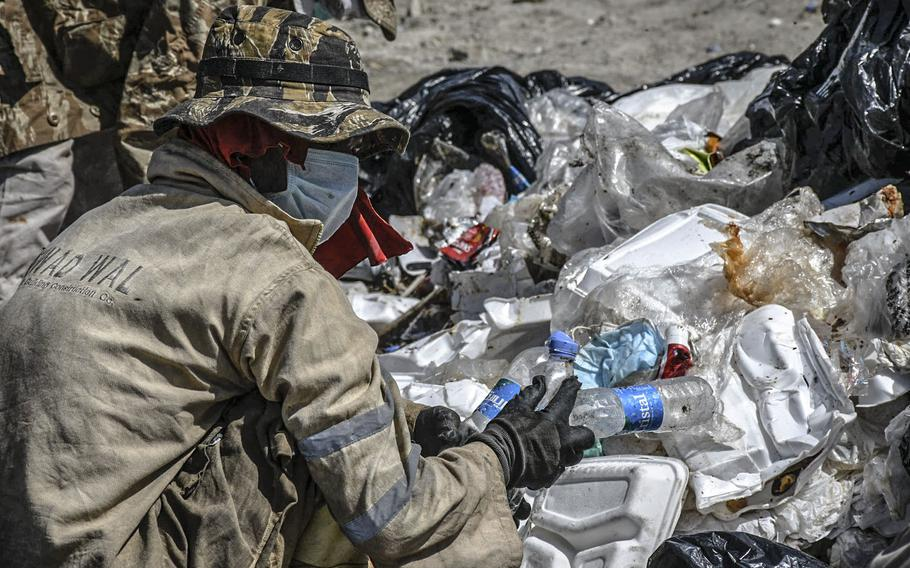Workers pick through trash from the U.S. Embassy in Kabul on Aug. 17, 2020 at what the Afghan government says is an illegal dump, two miles east of the airport.