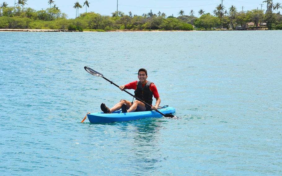 Jonah Lee kayaks toward Joint Base Pearl Harbor-Hickam, Hawaii, on his way to high school track practice, April 23, 2021.