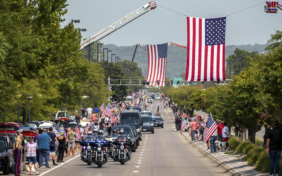 People line Abbot Drive to pay their respects to Marine Cpl. Daegan Page as the procession carrying his body drives through Omaha, Neb. on Friday Sept. 10, 2021. Page was one of 13 U.S. service members killed Aug. 26 in the bombing at the Kabul airport, which also killed at least 169 Afghans.