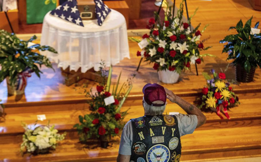 In this Thursday, Sept. 16, 2021, photo, David Gibbs Sr. salutes during the public visitation for Marine Cpl. Daegan Page at St. Paul Lutheran Church in Omaha, Neb. Gibbs, a Navy veteran, served 26 years. Cpl. Page was one of 13 U.S. service members killed Aug. 26 in a suicide bombing at the Kabul airport during the U.S. evacuation from Afghanistan.