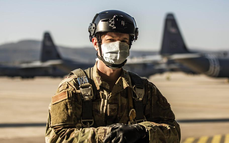 U.S. Air Force Staff Sgt. Kyle Lock, 435th Security Forces Squadron team member, prepares to board a C-130J Super Hercules aircraft at Ramstein Air Base, Germany, April 7, 2020. Lock is wearing a cloth mask and gloves to prevent the transmission of the coronavirus