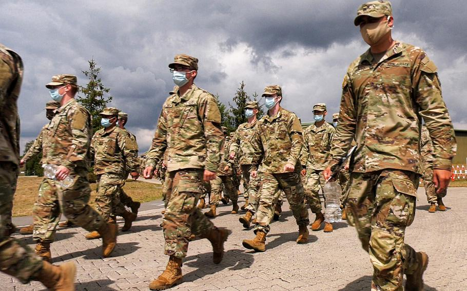 Soldiers, inbound from the United States to Europe, march to lunch at the Deployment Processing Center on Rhine Ordnance Barracks in Kaiserslautern, Germany July 17, 2020. All incoming personnel have to quarantine for two weeks, during which they are tested for the coronavirus.