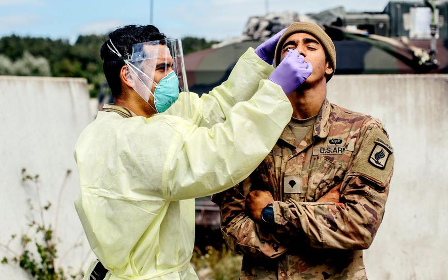 A U.S. Army medic paratrooper assigned to the 173rd Airborne Brigade swabs a soldier for the coronavirus at Hohenfels Training Area, Germany, Aug. 20, 2020, during Exercise Saber Junction 20.