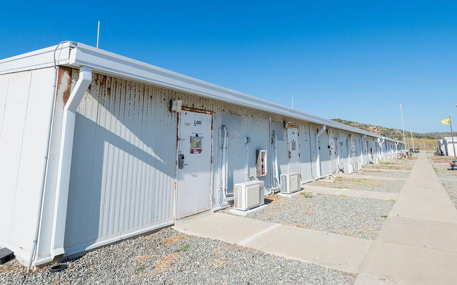 Temporary housing structures at Camp America house the soldiers charged with detention facility operations at Guantanamo Bay, Cuba. The structures were first built in 2002 and were meant to last only about five years, but military police officers will continue to use them through at least 2021, when a new, dormitory-style barracks could be completed.