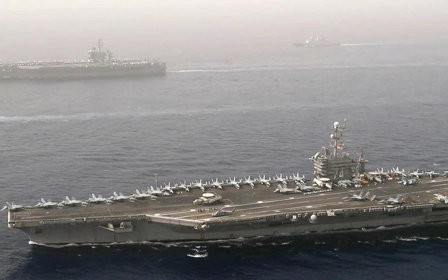 The aircraft carriers USS John C. Stennis, foreground, and USS Abraham Lincoln, along with their strike group ships,  conduct operations in the Mediterranean Sea, April 24, 2019.