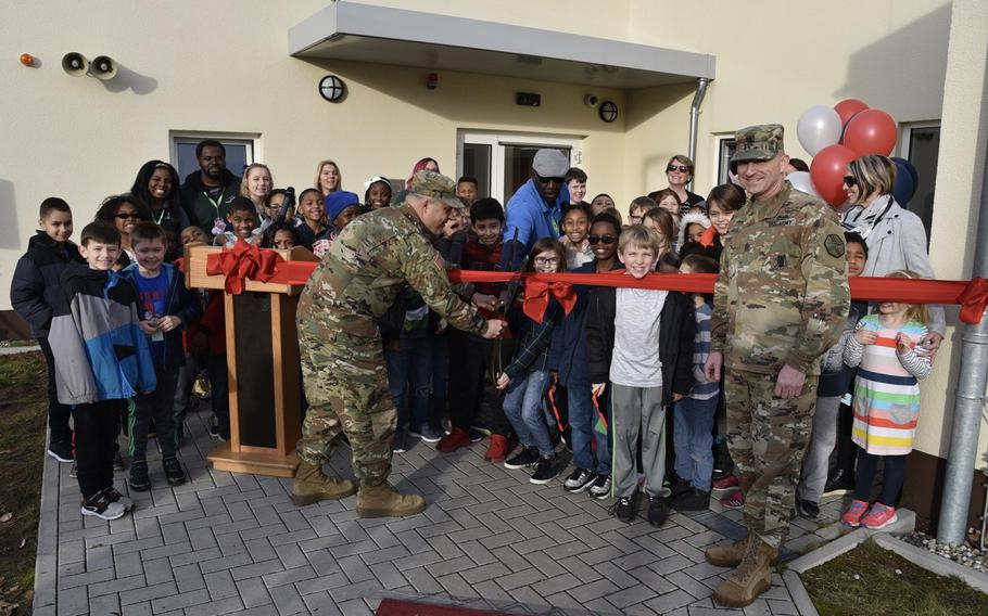 Along with students and staff from Sembach School Age Center, U.S. Army Garrison Rheinland-Pfalz Commander Col. Jason Edwards, left, and Command Sgt. Maj. Brett Waterhouse officially open the facility at Sembach Kaserne in February 2019. A damaged water line shut down services to the center and other buildings Wednesday, Sept. 11, 2019.