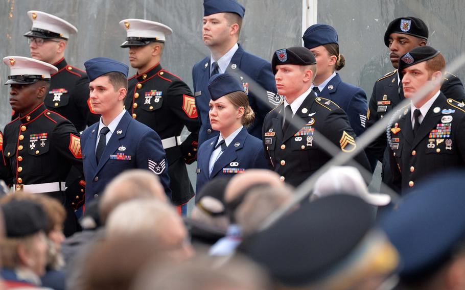Service members stand in formation as dignitaries prepare to enter at the commemorations at the Luxembourg American Cemetery marking the 75th anniversary of the Battle of the Bulge, Monday, Dec. 16, 2019.