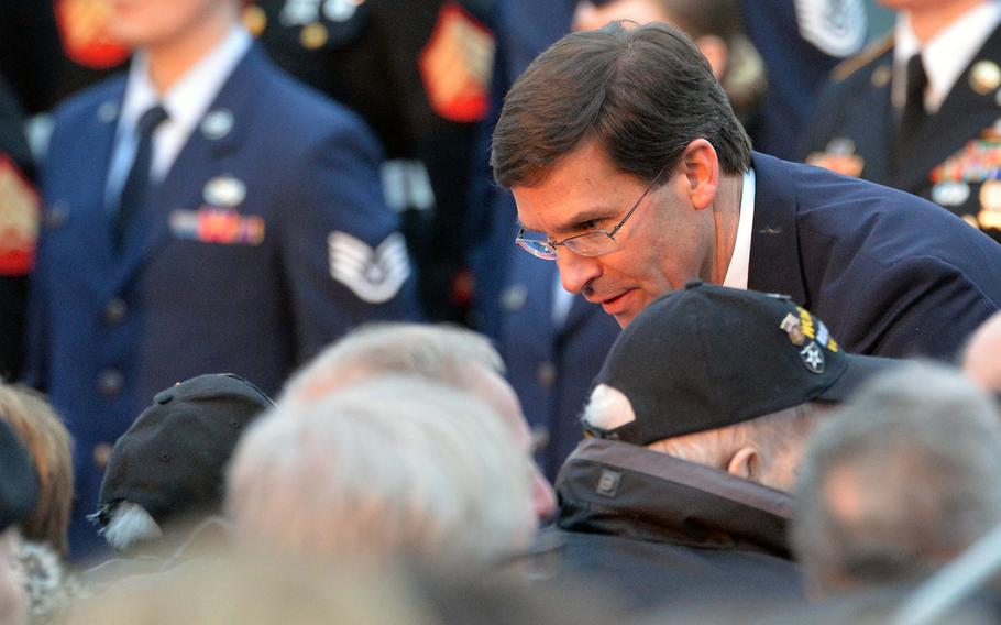 U.S. Defense Secretary Mark T. Esper talks to Battle of the Bulge veterans after laying a wreath at the commemorations marking the 75th anniversary of the Battle of the Bulge at Luxembourg American Cemetery  Monday, Dec. 16, 2019.