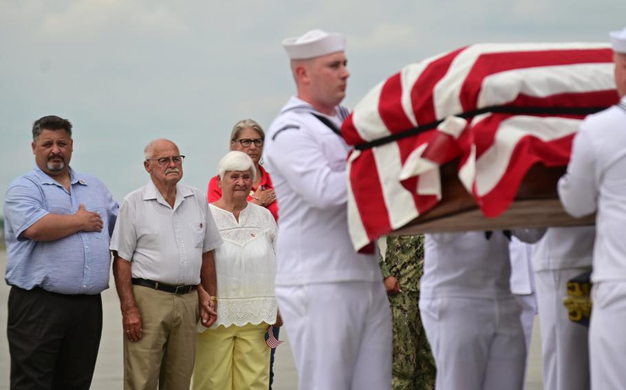 Orville Staffenhagen, second from left, brother of Navy Fireman 1st Class Neal Todd, stands at attention as his brother's remains are escorted from an airliner by a United States Honor Guard to a waiting hearse at Minneapolis/St. Paul International Airport on Thursday, July 8, 2021. Standing next to Staffenhagen is his son Anthony, left, and his wife, Delores. Todd was killed while stationed aboard the USS Oklahoma during the Japanese attack on Pearl Harbor on Dec. 7, 1941. His remains were positively identified through DNA samples in February of this year.