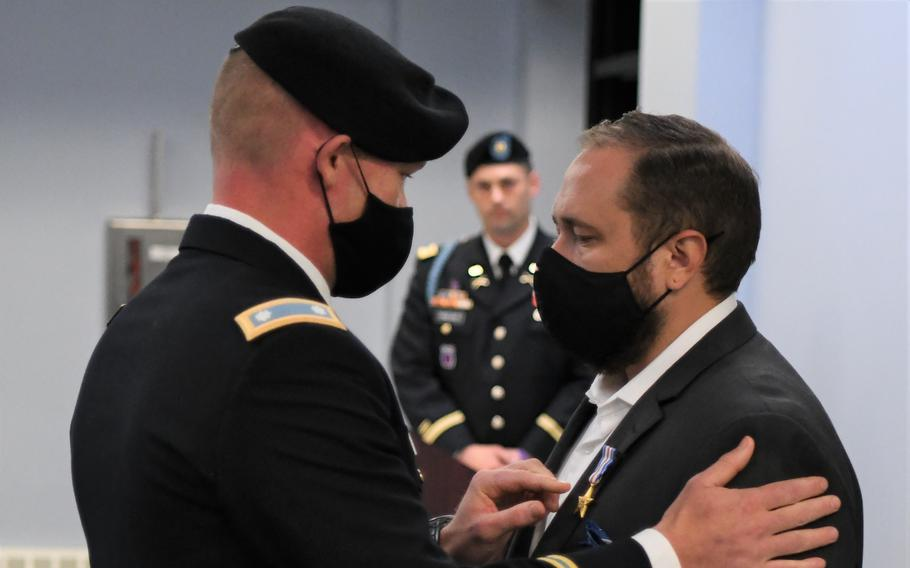 Retired Sgt. Adam Holroyd, right, assigned to 1st Battalion, 32nd Infantry Regiment, 3rd Brigade Combat Team, was awarded the Silver Star during a ceremony Sept. 1 at Fort Drum.