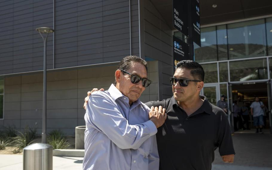 Agustin Abarca, left, is greeted by his son Juan after receiving citizenship in San Ysidro, Calif. on Thursday, Sept. 9, 2021.