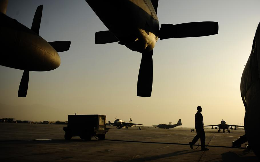 An airman from the 774th Expeditionary Airlift Squadron, boards a C-130H Hercules after completing pre-flight checks at Bagram Air Field, Afghanistan, Jan. 4, 2011.