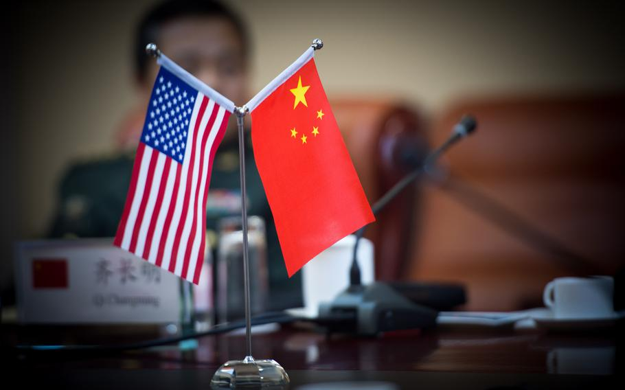 The United States flag and Chinese flag are displayed at a meeting between officials in Beijing, China,  on Feb. 21, 2014.