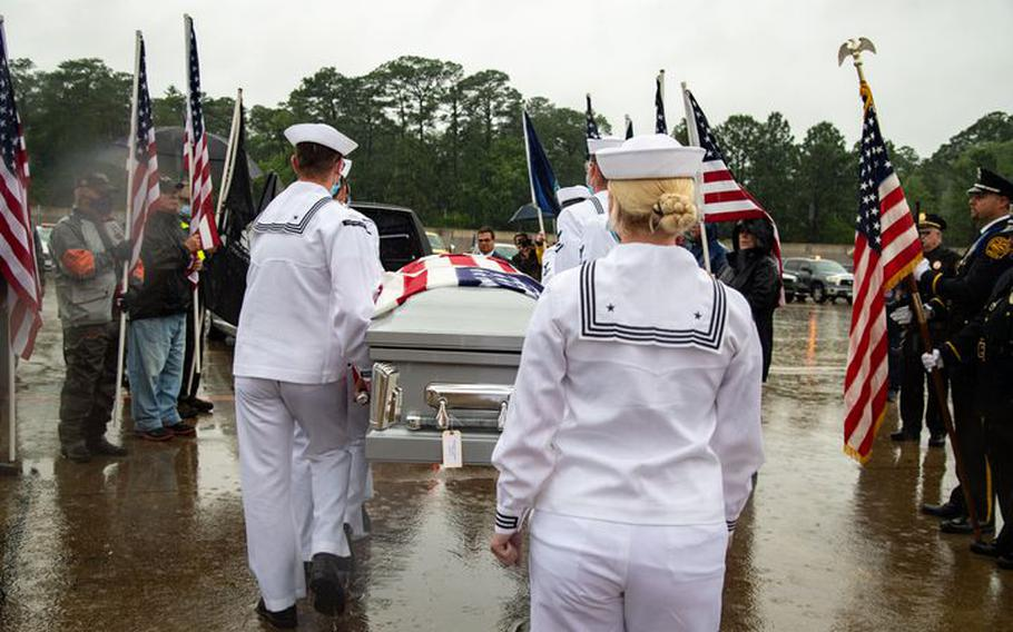 William Eugene Blanchard's casket is carried to a hearse at Norfolk International Airport on Thursday, June 3, 2021, in Norfolk, Va. The sailor from Tignall, Georgia, died aboard the battleship USS Oklahoma when it was torpedoed in Pearl Harbor in 1941.