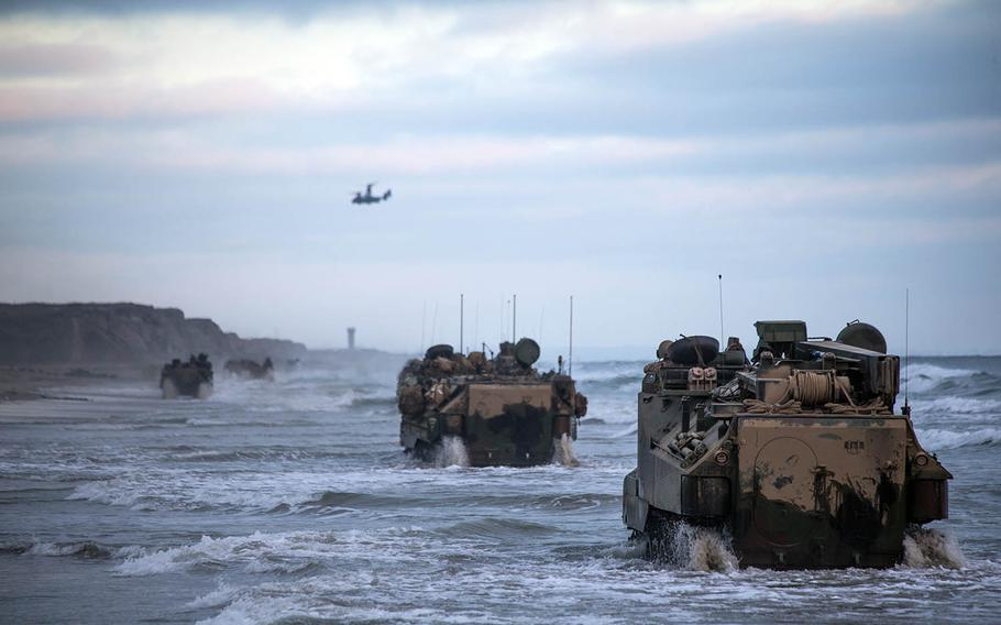 Marines with Bravo Company, Battalion Landing Team 1/4, 15th Marine Expeditionary Unit, drive assault amphibious vehicles at Marine Corps Base Camp Pendleton, Calif., July 14, 2020.