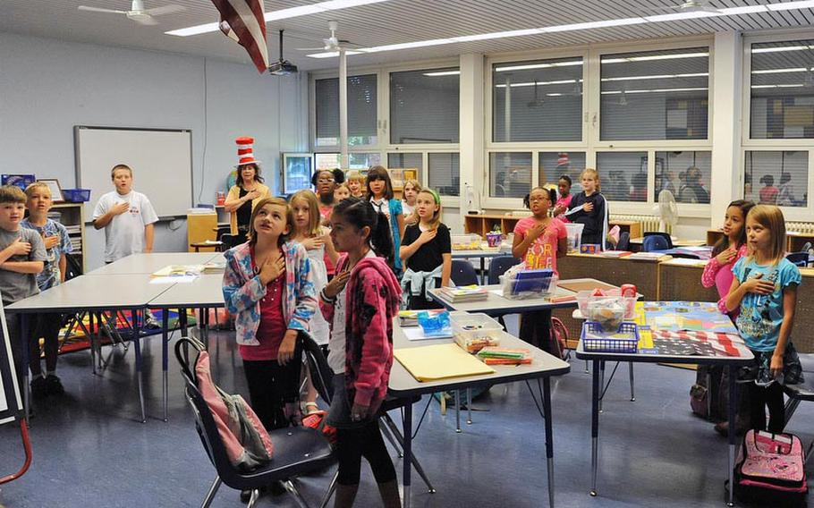 Mannheim Elementary School pupils in Gloria Yokley's fourth-grade class recite the Pledge of Allegiance on the first day of school for DODDS-Europe students. It is the final year for the school, as the Mannheim military community closes down.