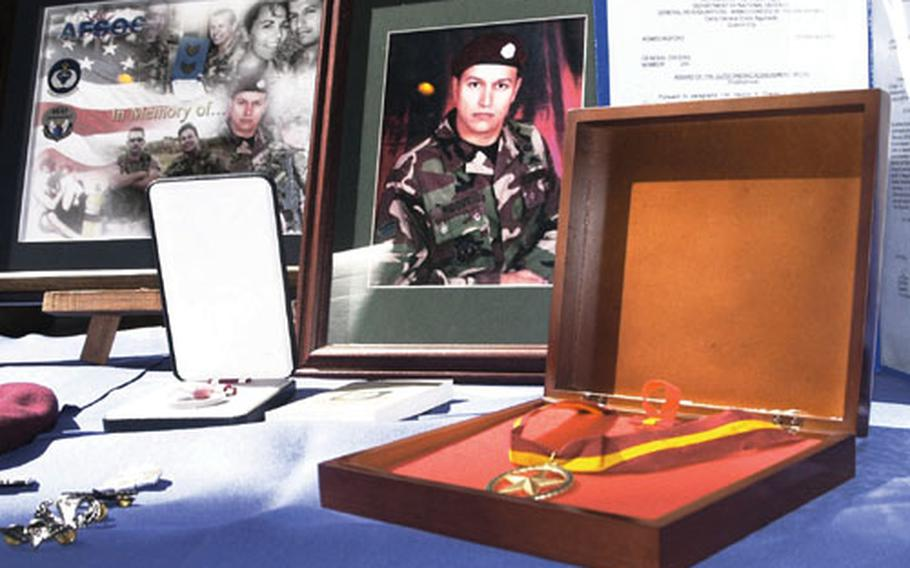 Staff Sgt. Juan Ridout, one of two Kadena special operations pararescuemen who died in a helicopter crash in the Philippines, received a meritorious service medal posthumously at a memorial service in February on Okinawa.