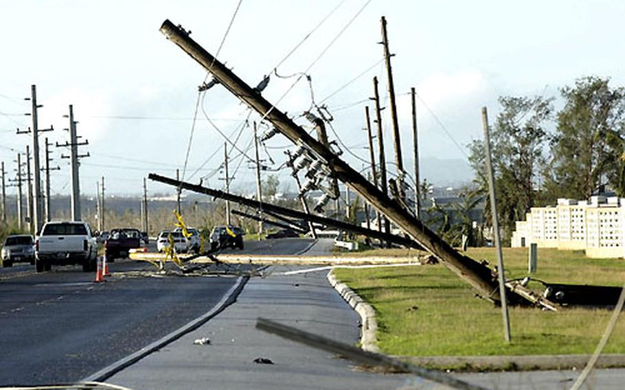 Utility poles on Guam are left toppled in the wake of Typhoon Pongsona.
