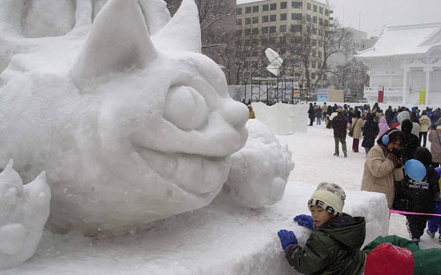 Children enjoy snow sculptures of Japanese cartoon characters, a popular subject for the frosty creations of perishable art.