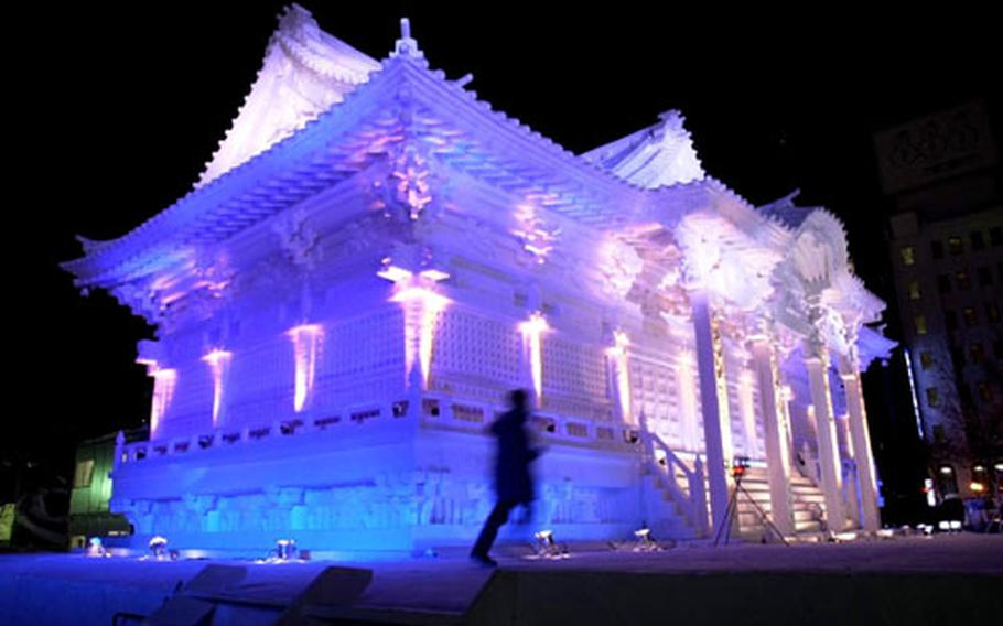 A snow sculpture of the Nikkozan Rinnoji Temple in Nikko, Japan, lights up the night at last year's Sapporo Snow Festival.