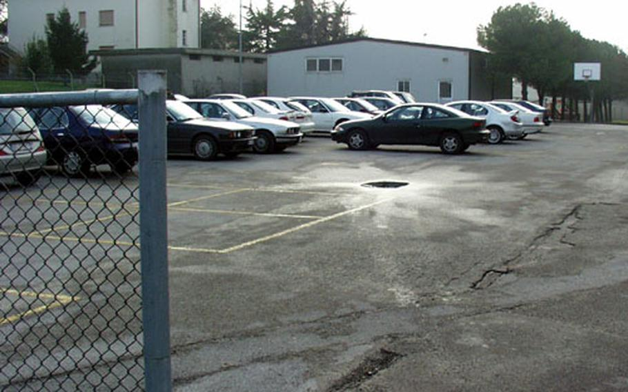 This parking lot at Aviano Air Base was used last year as a playground for elementary students. When the consolidated school opened and other tenants moved into the building, the cars followed.